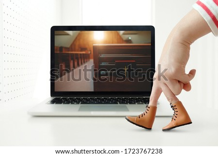 Church services online concept, Home church during quarantine coronavirus Covid-19, Online church from home new normal concept, woman hand finger walking on laptop, Church interior with bible. #1723767238