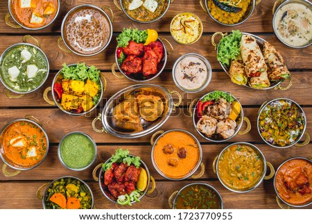 Traditional indian cuisine dish masala samosas topping meat chicken makhani vegetables top view Royalty-Free Stock Photo #1723770955