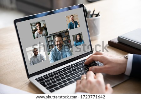 Close up of businessman use modern laptop have webcam conference or briefing with diverse colleagues, make employee talk brainstorm on video call on computer with coworkers or team, online meeting #1723771642