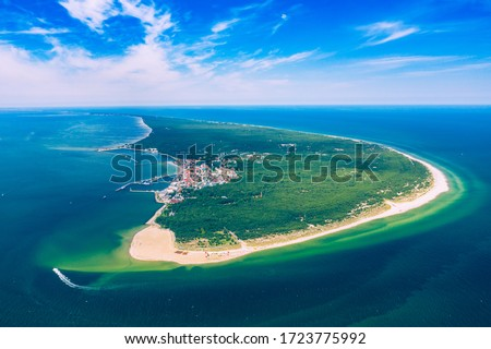Aerial view of Hel Peninsula in Poland, Baltic Sea and Puck Bay (Zatoka Pucka) Photo made by drone from above. Royalty-Free Stock Photo #1723775992