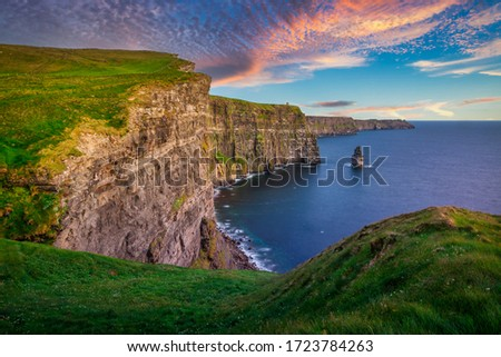 Amazing Cliffs of Moher at sunset in Ireland, County Clare. Royalty-Free Stock Photo #1723784263