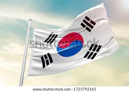 Korea south national flag cloth fabric waving on the sky with beautiful sky - Image Royalty-Free Stock Photo #1723792165