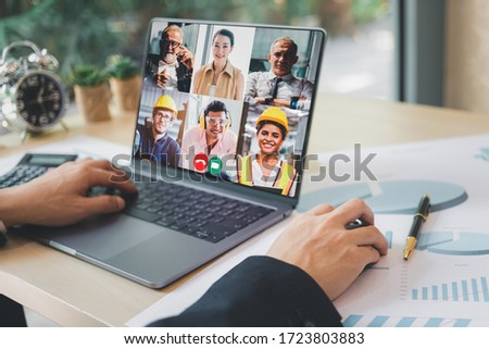 Group of creative construction engineer using laptop for video conference meeting and discussion about new project. Work from home, Working remotely during corona virus crisis, New normal working. #1723803883