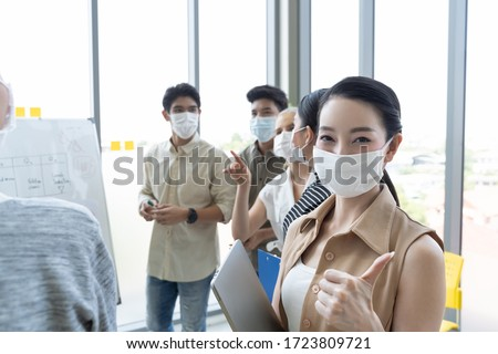 Group of asian business people meeting and working in office and wear mask for protect  prevent infection corona virus covid 19. #1723809721