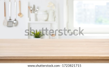 Wooden texture table top on blurred kitchen window background #1723821715