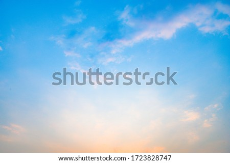 Beautiful sky with cloud before sunset. Colorful sky in twilight background. Bright Blue, Orange And Yellow Colors Sunset. Royalty-Free Stock Photo #1723828747