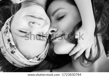 Daughter and mother hug in the photo. Cheek to cheek. Tenderness between mother and daughter #1723830784