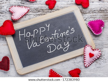 Happy Valentine's Day. Handwritten message on a chalkboard #172383980