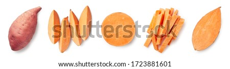 Set of fresh whole and sliced sweet potatoes isolated on white background. Top view Royalty-Free Stock Photo #1723881601