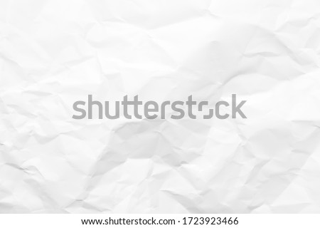 White crumpled paper texture background. Clean white paper. Top view. Royalty-Free Stock Photo #1723923466