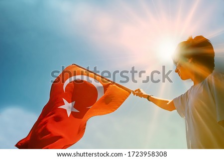 Young boy holding Turkish flag. #1723958308