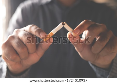 Man refusing cigarettes concept for quitting smoking and healthy lifestyle dark  background. or No smoking campaign Concept.	 #1724010937
