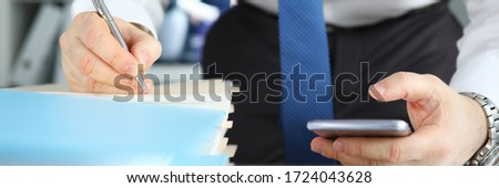 Businessman signs stack documents in table office. Man created workplace at home during quarantine. Simplification procedure for signing documents during self-isolation. Ability to quickly sign