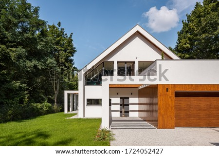 Modern designed white house with big garden and garage, exterior view #1724052427