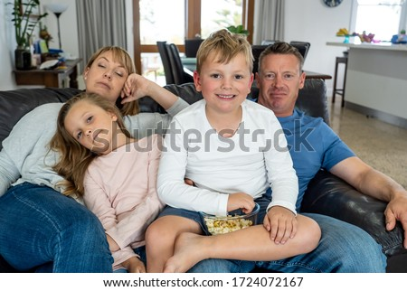 COVID 19 Outbreak. Bored and frustrated family watching tv at home feeling depressed  Mental health Impact of lockdown social distancing and Job losses due to coronavirus. #1724072167