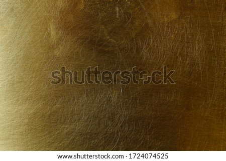 Scratched textured surface of old brass, background #1724074525