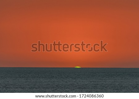 The green flash at sunset over the Pacific. Royalty-Free Stock Photo #1724086360