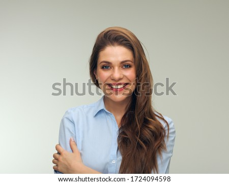 Smiling woman dressed blue shirt isolated studio portrait. Royalty-Free Stock Photo #1724094598
