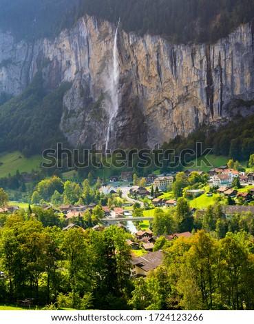 The Lauterbrunnen Village Church and Staubbach Falls in Lauterbrunnen, Switzerland. #1724123266
