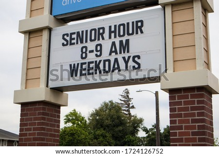 OAKDALE, CALIFORNIA / USA - APRIL 29, 2020: Pharmacy posts special shopping hours for senior citizens #1724126752