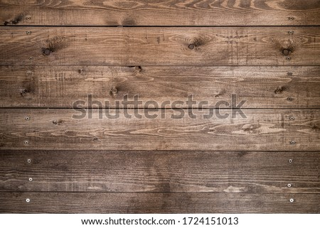 Old brown wood background made of dark natural wood in grunge style. The view from the top. Natural raw planed texture of coniferous pine. The surface of the table to shoot flat lay. Copy space #1724151013
