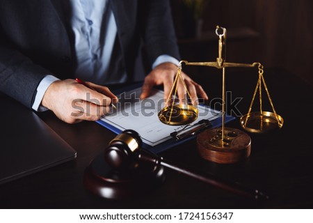 Lawyer office. Statue of Justice with scales and lawyer working on a laptop. Legal law, advice and justice concept. #1724156347