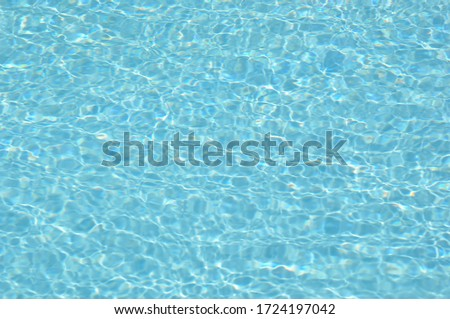 Clean water in the sunny day in the pool #1724197042