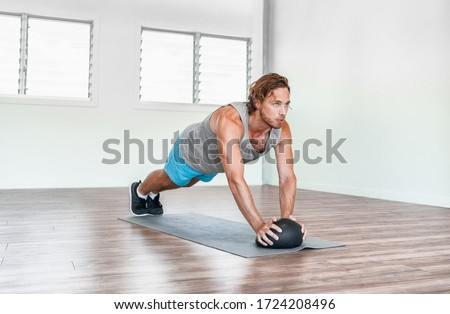 Home gym medicine ball workout abs exercise stability body exercises man training tricep pushups. #1724208496