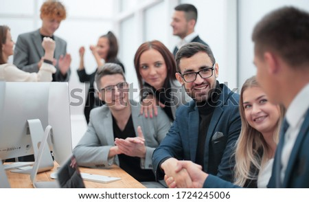 business people shaking hands sitting at the office Desk. Royalty-Free Stock Photo #1724245006