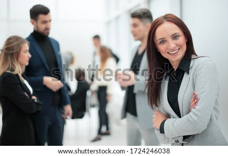 young business woman standing in modern office. #1724246038