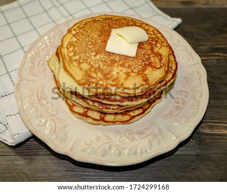 Picture of pancakes with butter.