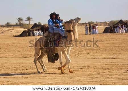 DOUZ,TUNISIA. 21 DECEMBER 2018.  Festival of the Sahara in Douz, Tunisia. #1724310874