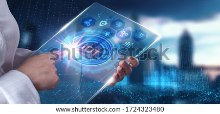 Internet of things - IOT concept. Businessman offer IOT products and solutions. Young businessman  select the abstract chip with text IoT on the virtual display
