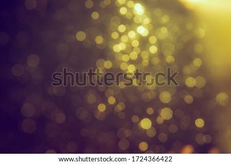 Gold bokeh blur defocus in black use for backgeound #1724366422