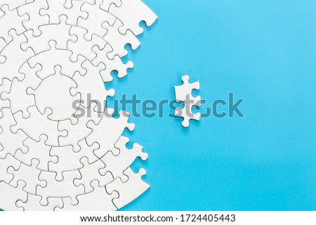 White jigsaw puzzle pieces on a blue background. Problem solving concepts. Texture photo with copy space for text #1724405443