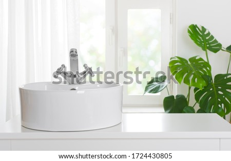 Hygienic wash basin with chrome faucet on bathroom window background Royalty-Free Stock Photo #1724430805
