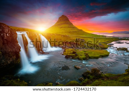 Incredible photo of Kirkjufellsfoss waterfall at sunset. Location famous place Kirkjufell volcano, Iceland, Europe. Image of popular tourist attraction of the world. Discover the beauty of earth.