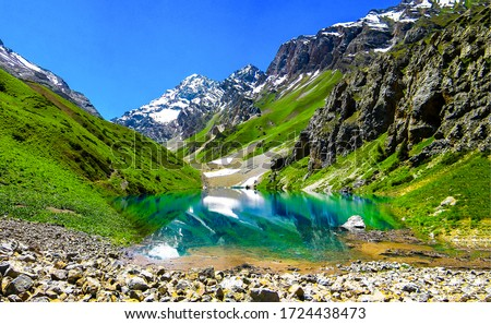 Mountain blue lake water landscape. Lake in mountains. Mountain lake view. Mountain lake landscape #1724438473