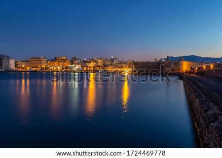 Heraklion,crete/Greece - May 5th 2020: View of the port of Heraklion and the watefront at blue hour #1724469778
