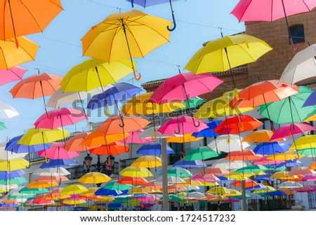 Colorful umbrellas at small Spanish city of Torrox. #1724517232