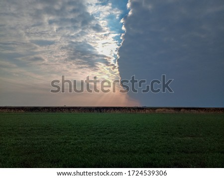The boundary of atmospheric fronts. The sharp boundary of the clouds in the sky. Royalty-Free Stock Photo #1724539306