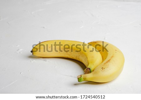 Bananas on a light background copy space. #1724540512