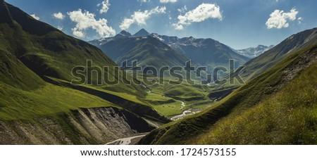 The most beautiful valley on Omalo Shatili trek. In georgian Caucasus. Royalty-Free Stock Photo #1724573155