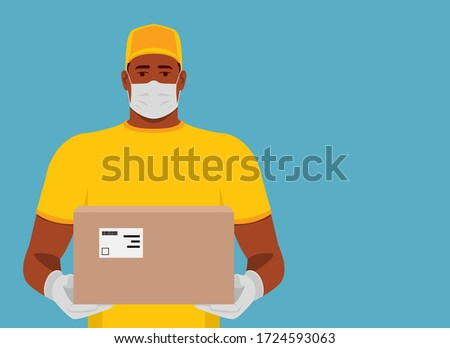 Delivering parcel. African American delivery man holding cardboard box. Courier in medical mask and gloves. Carrying package. Sterile cargo. #1724593063