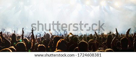 banner of cheering crowd and stage lights with space for your text Royalty-Free Stock Photo #1724608381