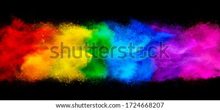 colorful rainbow holi paint color powder explosion garland banner isolated on dark black wide panorama background. peace rgb beautiful party concept #1724668207