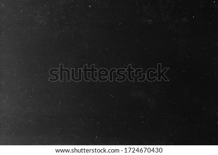 Black grunge background. Old film grain texture. Grunge wallpaper. Retro film photography effect. Analog foto. Frame. redaction. 90s Royalty-Free Stock Photo #1724670430