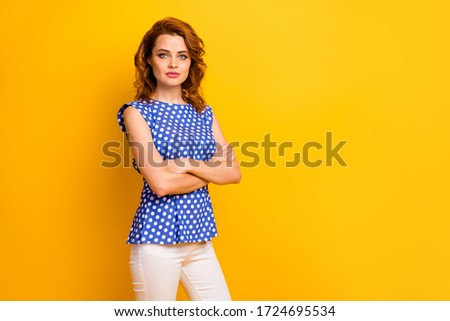 Portrait of her she nice fashionable attractive lovely content serious wavy-haired girl wearing pin-up dress folded arms isolated on bright vivid shine vibrant yellow color background #1724695534