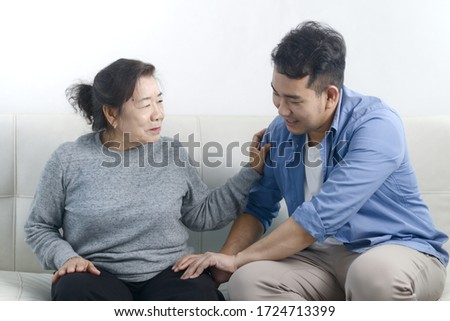 Asian man massage his mother at home, lifestyle concept. #1724713399