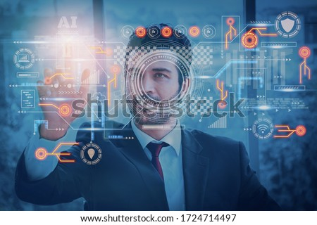 Businessman using interface screen display to analyze and process operations using artificial intelligence or AI system,concept futuristic innovation and technology,internet of Things or iot,big data Royalty-Free Stock Photo #1724714497